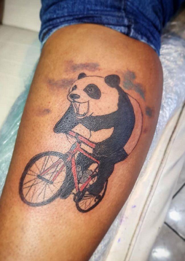'Panda riding a Bicycle' Tattoo