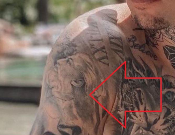 Roger shoulder tattoo