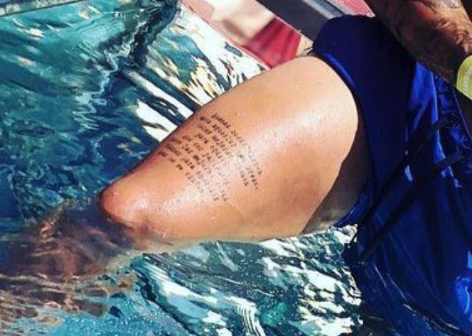 Roger thigh tattoo