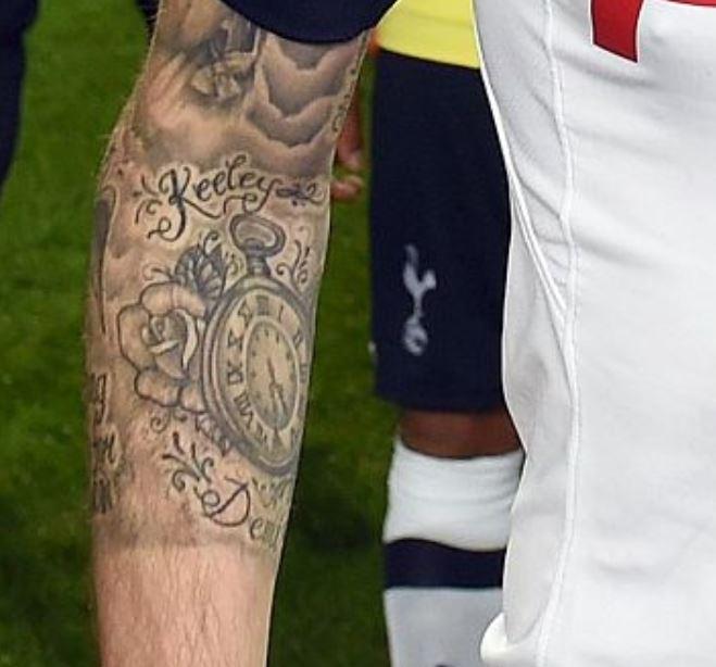 Ryan clock and rose tattoo