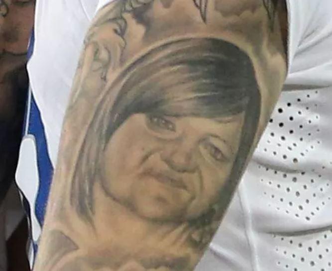 Ryan portrait on arm tattoo