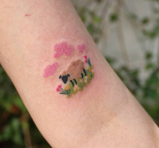 'Sheep with Pink Clouds and Flowers' Tattoo