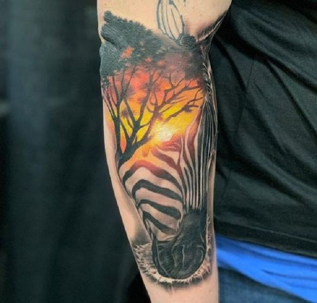 Sunset-Theme Zebra Tattoo