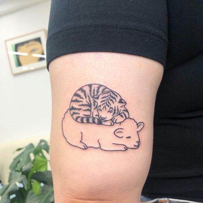 'Tiger sleeping on Sheep' Tattoo