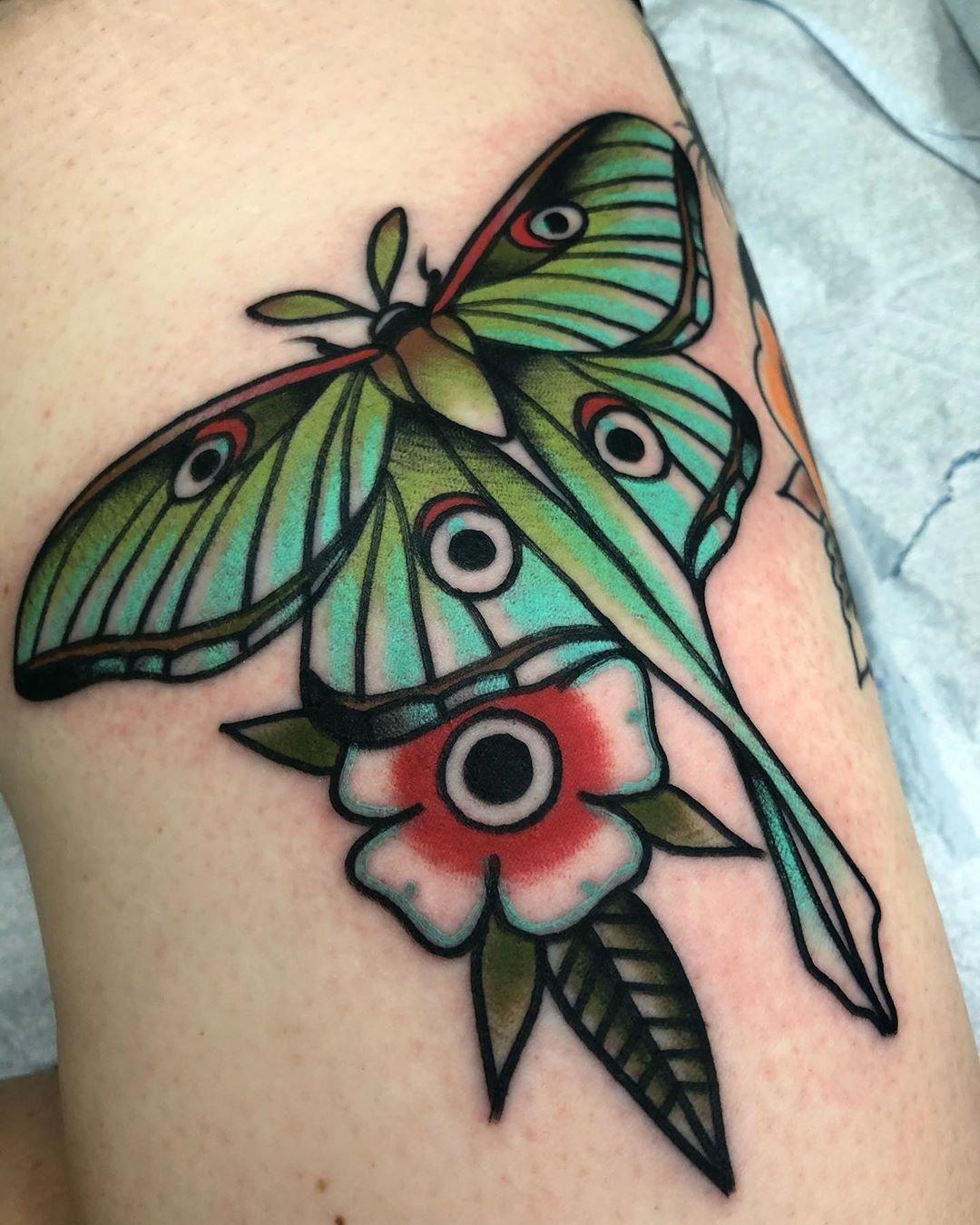 1 Vibrant Luna Moth Tattoo With Flower Designs