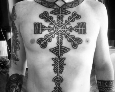 8 man with rune norse chest tattoo