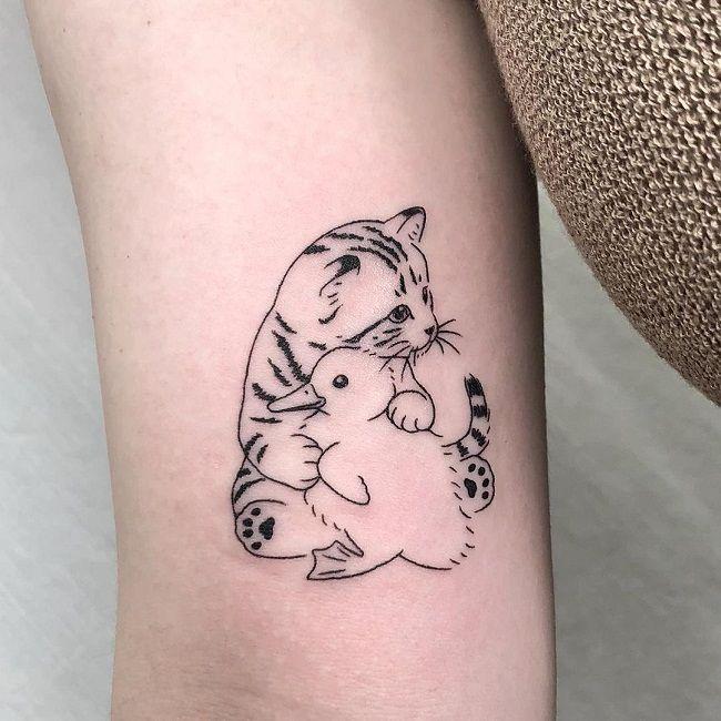 'Cat hugging a Duck' Tattoo