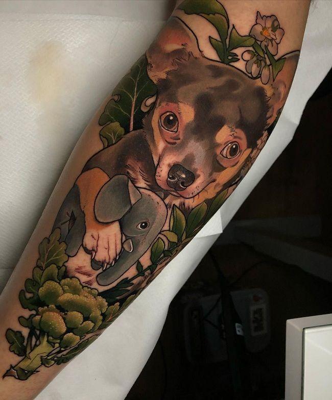 'Chihuahua holding a Baby Elephant' Tattoo
