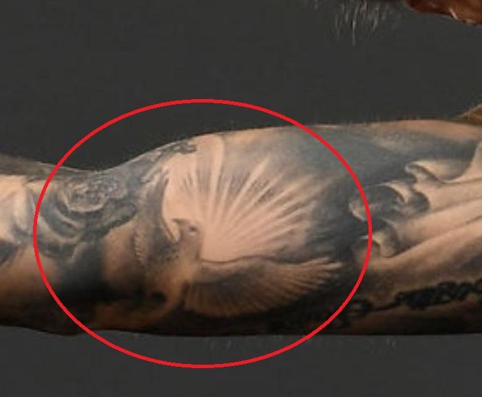 Germaine flying bird tattoo