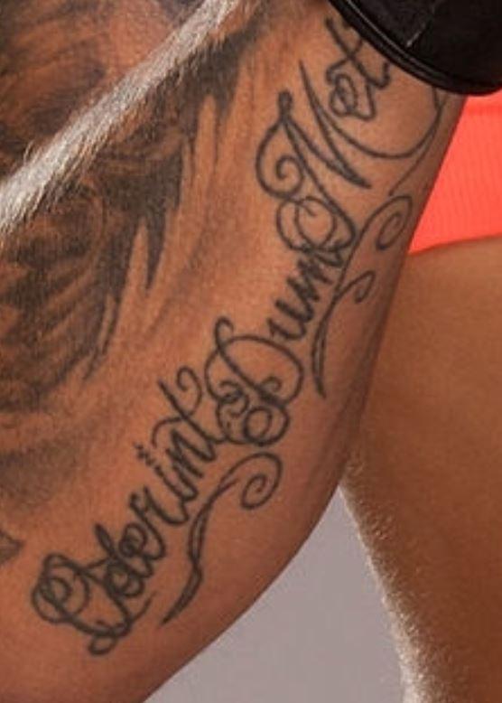Germaine writing on forearm tattoo