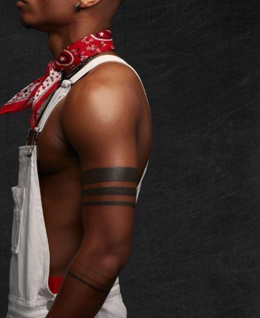 KiDi bands on arm tattoo