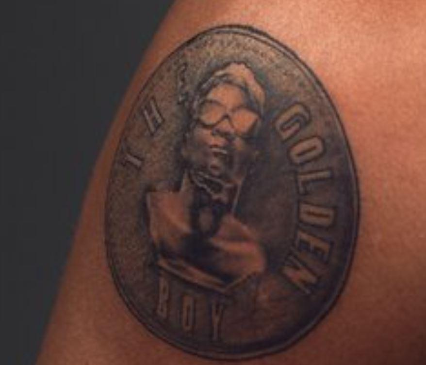 KiDi bicep tattoo