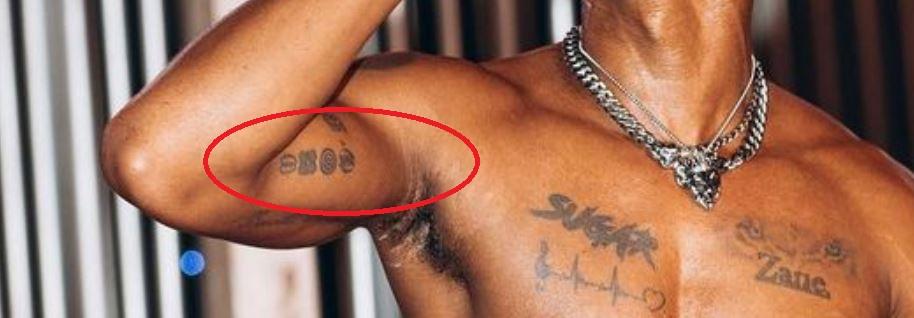 KiDi inner arm tattoos