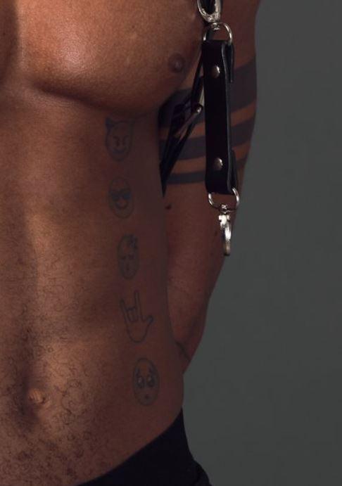 KiDi smileys on stomach tattoo