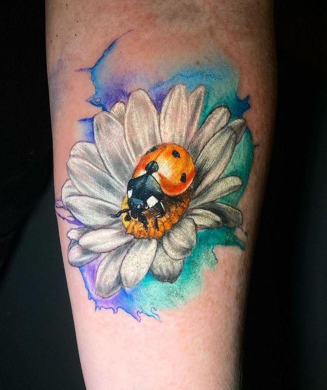 'Ladybird sitting on a Daisy Flower' Tattoo