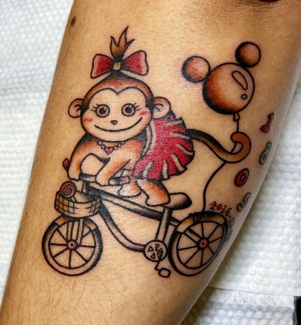 'Monkey riding a Bicycle' Tattoo