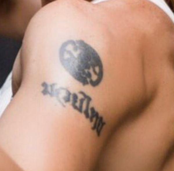 Valentina bicep tattoo