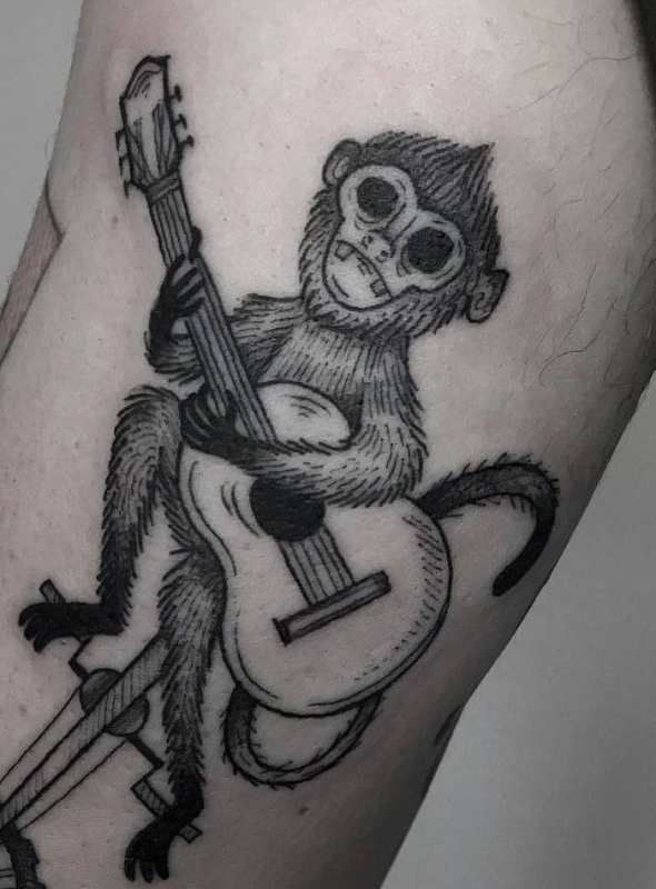 'A Monkey playing a Guitar' Tattoo