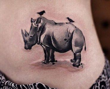 'Birds sitting on the Rhinoceros' Tattoo