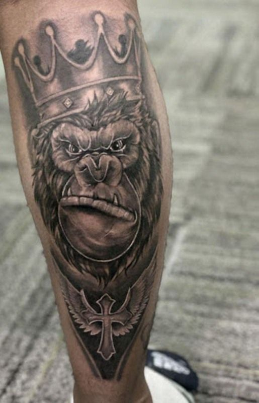 The Gorilla is a herbivorous mammal, who mainly lives in dense forests. They have a hairless face with small eyes, large man-like hands, broad chests and shoulders. They usually live in groups, with the leader tagged as a silverback. Their loyal, friendly, gentle, and compassionate nature are the main reasons why people get themselves inked with gorilla tattoos. They symbolize intelligence, gentleness, and compassion. There is an endless list of different types of gorilla tattoos, each having its respective meaning, and why people get themselves inked with gorilla tattoos. Here, in this article, you will find different gorilla tattoos with their respective meaning and explanations. 'Gorilla wearing a Crown' Tattoo