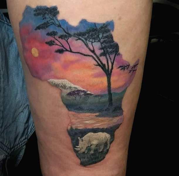 Landscape-Theme Rhinoceros Tattoo