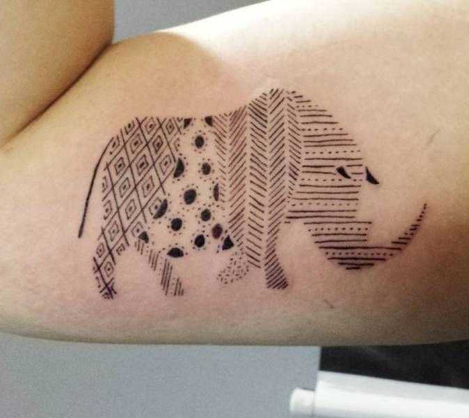 Patterned Styled Rhinoceros Tattoo