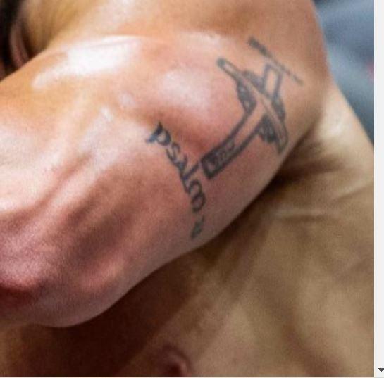 Rich cross tattoo