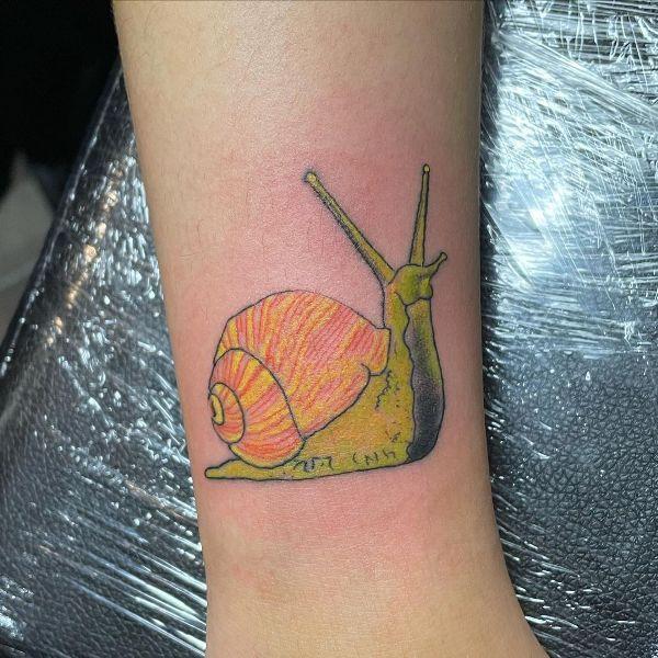 Yellow Snail Tattoo